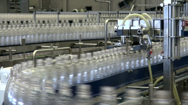 ms shot of plastic bottle moving in bottling plant at beverage industry / gerolstein, rhineland palatinate, germany  - abundance stock videos & royalty-free footage