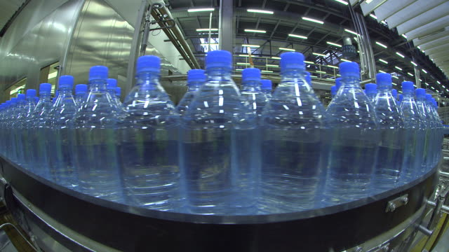 ms shot of plastic bottle moving in bottling plant at beverage industry / gerolstein, rhineland palatinate, germany  - bottling plant stock videos and b-roll footage