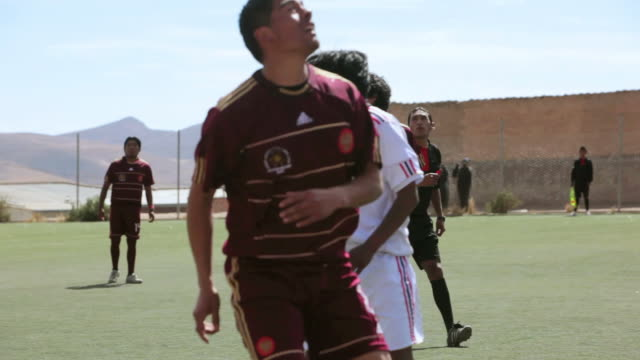 shot of players playing soccer game / potosi bolivia - bolivien stock-videos und b-roll-filmmaterial