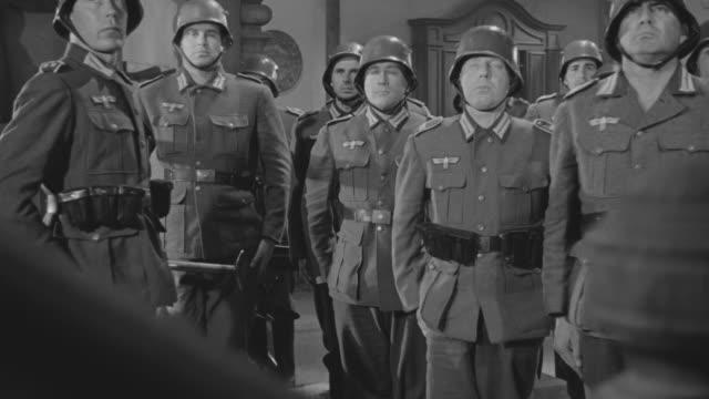 ms shot of pointed gun soldiers standing up - deutsches militär stock-videos und b-roll-filmmaterial