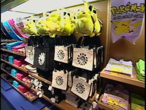 shot of pokemon merchandise at the pokemon store in new york city. merchandise includes video games, clothing, bags and stuffed animals. - slipper stock videos & royalty-free footage