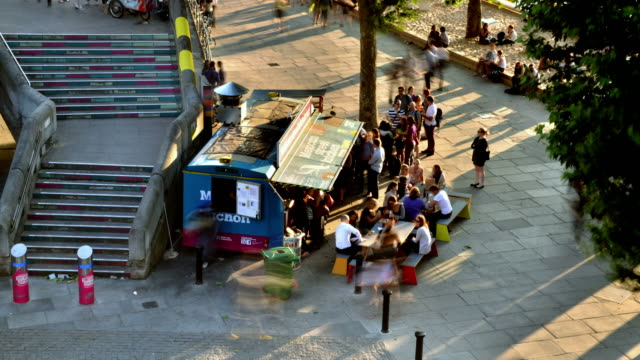 WS T/L Shot of Pop up restaurant south bank London early evening with tourists and office workers queue and passing / London, Greater London, United Kingdom
