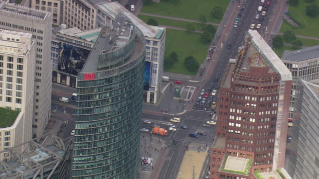 ms aerial shot of postdamer platz with buildings and traffic on streets / germany - potsdamer platz stock videos & royalty-free footage