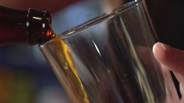 ecu td tu slo mo shot of pouring beer into glass / seattle, washington, united states - füllen stock-videos und b-roll-filmmaterial