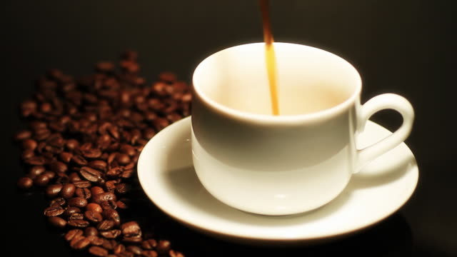 cu shot of pouring coffee in cup / bergen, hordaland, norway - large group of objects stock videos & royalty-free footage