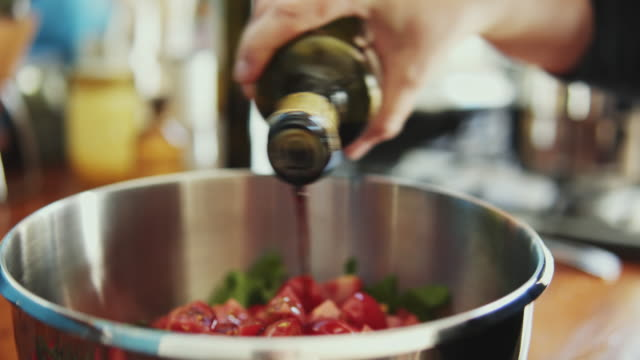 shot of pouring oil on salad. - salad oil stock videos & royalty-free footage