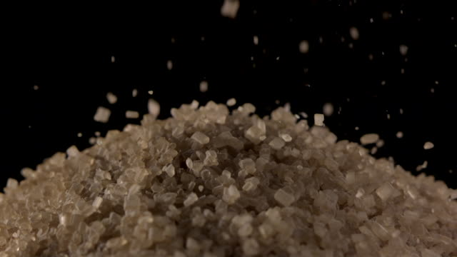 CU SLO MO Shot of pouring sugar cane on pile of sugar cane / Studio, New Jersey, United States