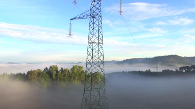 MS AERIAL TU Shot of power lines crossing Tuscan hills at Sun rising / San Gimignano, Tuscany, Italy