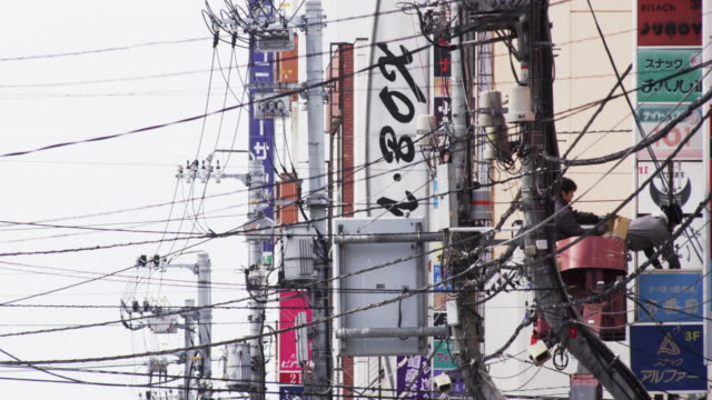 shot of power lines in a japanese city - cable video stock e b–roll