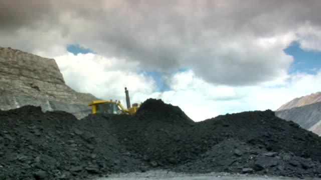 ms shot of power shovel moving coal at mine / andorra, teruel, spain - coal stock videos & royalty-free footage