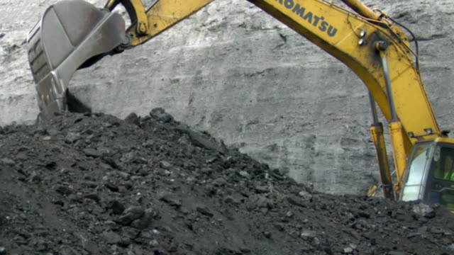 MS TS PAN Shot of power shovel piling up coal / Andorra, Teruel, Spain