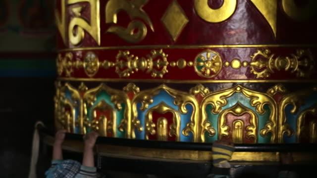 CU Shot of Prayer wheel in shrine / Lukla, Nepal