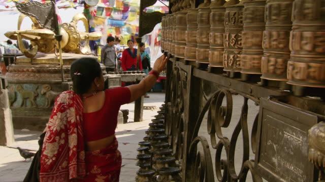 MS Shot of prayer wheel of Boudhanath Stupa temple / Kathmandu, Nepal