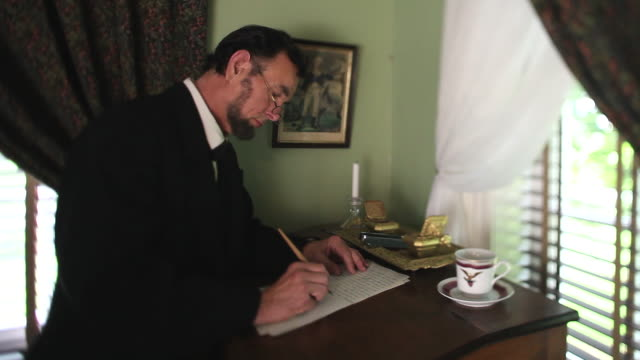 MS Shot of President Abraham Lincoln sitting at desk and writing / Clear Spring, Maryland, United States