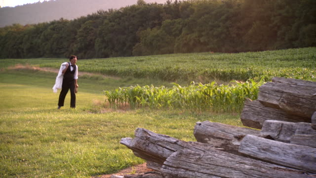 WS TS Shot of President Abraham Lincoln strolling through field during sunset / Clear Spring, Maryland, United States