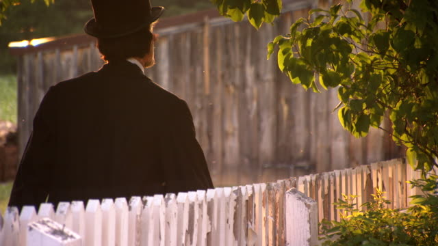 MS TS Shot of President Abraham Lincoln walking along fence / Clear Spring, Maryland, United States