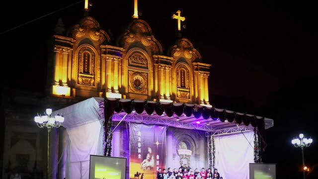 ms td shot of priest preached in church at christmas evening / xian, china - christianity stock videos & royalty-free footage