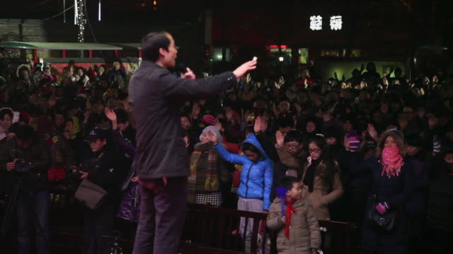 ms shot of priest preached in church at christmas evening / xian, china - preacher stock videos and b-roll footage