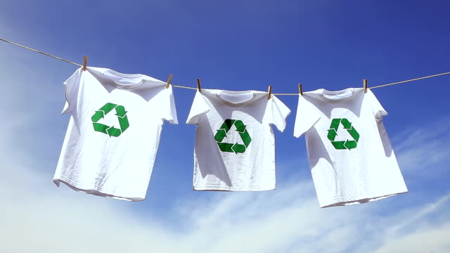 ms shot of printed recycling t-shirts and clear sky / seoul, south korea - recycling stock videos & royalty-free footage