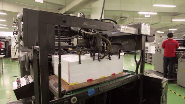 WS Shot of Printing machine and factory worker / Shenzhen, Guangdong, China