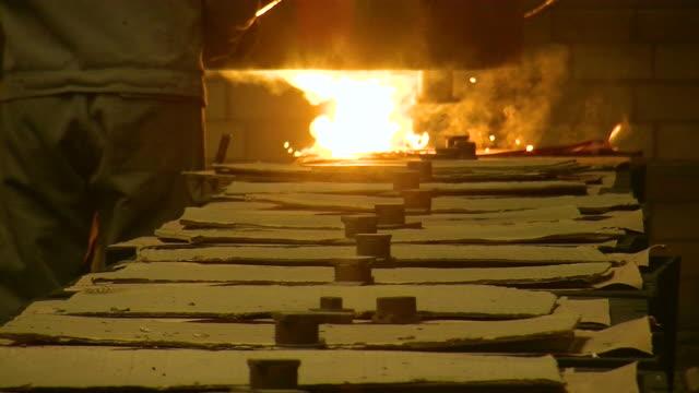 ms shot of production hall at foundry, molding procedure / duisburg, north rhine westphalia, germany - ドラム容器点の映像素材/bロール