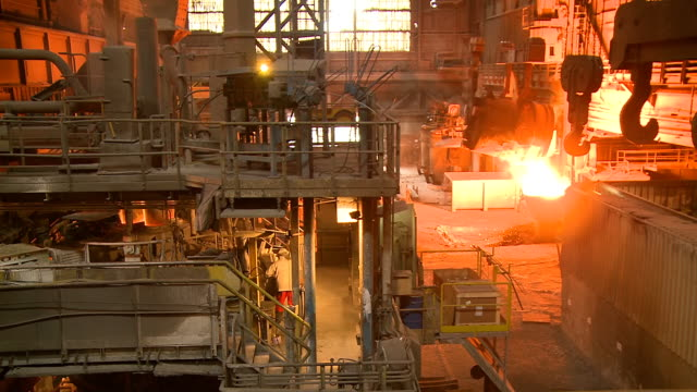 ms shot of production hall at steel works / esch sur alzette, esch, luxembourg - acciaieria video stock e b–roll