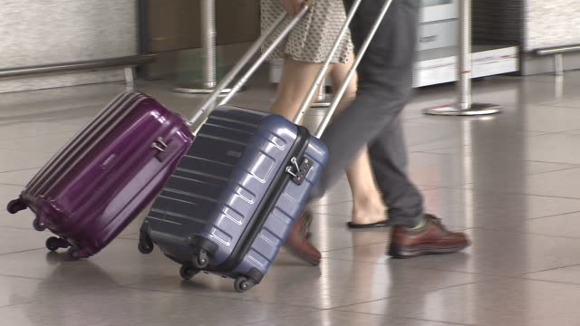 shot of pulling luggage at incheon international airport - schuhwerk stock-videos und b-roll-filmmaterial