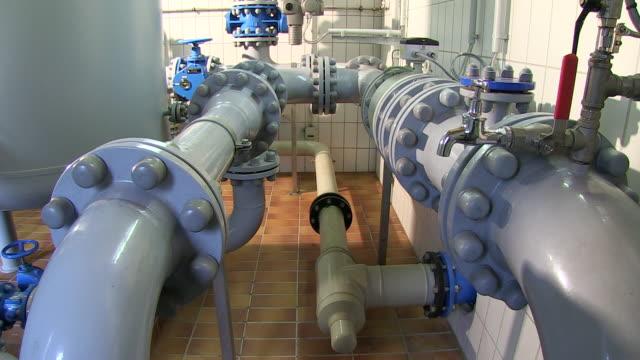 ms tu shot of pump station at water reservoir / konz, rhineland-palatinate, germany - wasserpumpanlage stock-videos und b-roll-filmmaterial