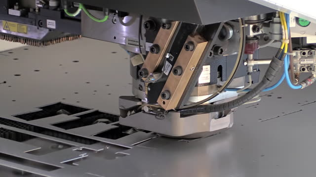 CU Shot of punch laser machine processing / Konz, Rhineland Palatinate, Germany
