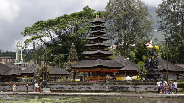 ms shot of pura ulun danu temple at lake bratan and people roaming near temple / bedugul, bali, indonesia   - pura ulu danau temple stock videos & royalty-free footage