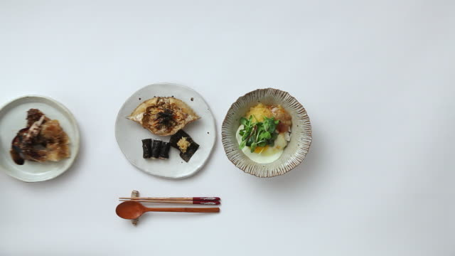 MS Shot of putting crab marinated in soy sauce beside foods / Seoul, South Korea