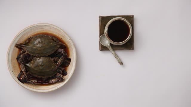 ms ha shot of putting kanjang gaejang (marinate in soy sauce) on table / seoul, south korea - positioning stock videos & royalty-free footage