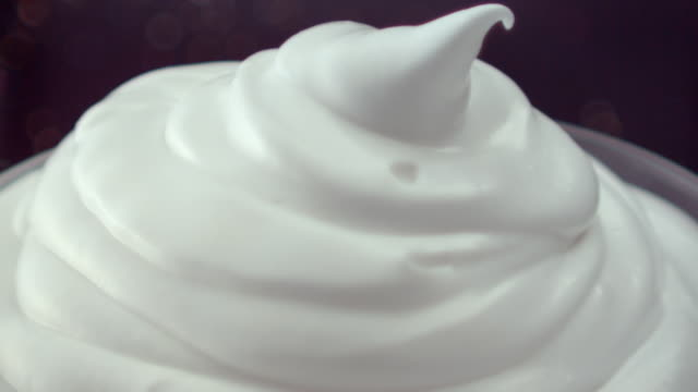 ECU SLO MO Shot of putting sprinkles and silver beads on whipped cream/ Seoul, South Korea
