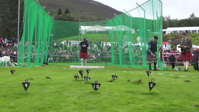 ms shot of putting stone at braemar royal highland games / braemar, aberdeenshire, scotland - highland games stock videos & royalty-free footage