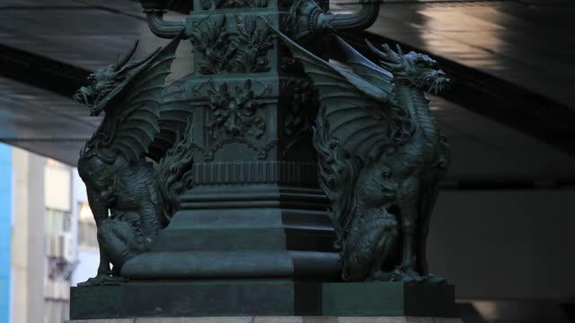 cu shot of qilin bronze sculpture / nihonbashi, tokyo, japan - animal representation stock videos and b-roll footage