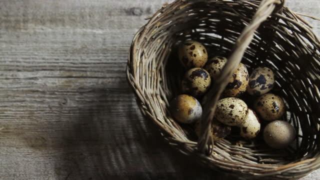 ms pan shot of quail eggs in basket / london, united kingdom  - einige gegenstände mittelgroße ansammlung stock-videos und b-roll-filmmaterial