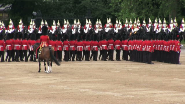ms shot of queen's birthday parade with horse gurads in trooping colour at whitelhall / london, united kingdom - queen royal person stock videos and b-roll footage
