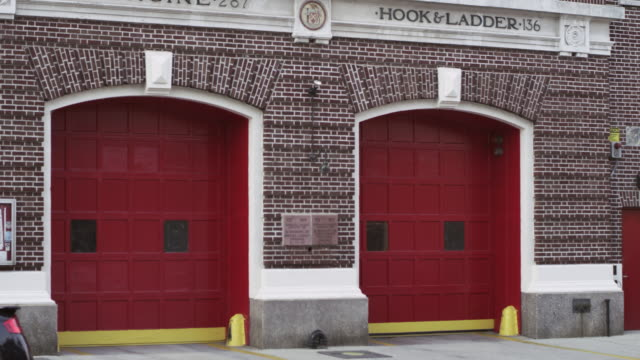 ms td shot of queens fire station / new york, united states - fire station stock videos & royalty-free footage