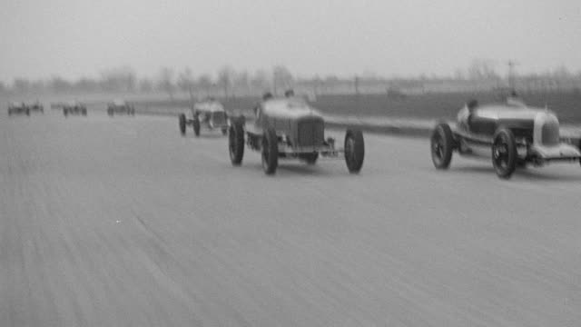 MS POV Shot of Race car speeding around race track straight back other race cars on track