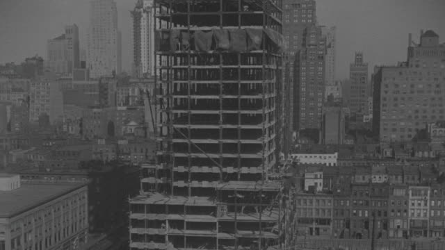 ms shot of radio city music hall being built in new york city's rockefeller center / new york, united states - rockefeller center video stock e b–roll