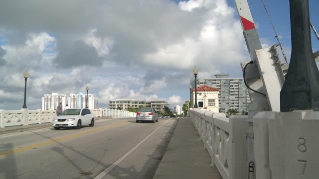 ms shot of rail crossing going up on drawbridge on venetian causeway / miami beach, florida, united states - drawbridge stock videos and b-roll footage
