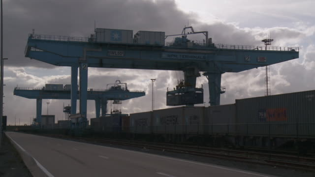 ms shot of rail freight and containers on dock in port / zeebrugge, flanders, belgium    - rail freight stock videos and b-roll footage