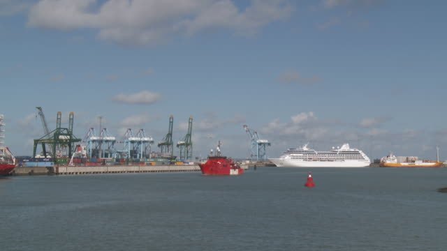 ws shot of rail freight containers and ferry boat  on dock in port / zeebrugge, flanders, belgium    - ferry stock videos & royalty-free footage
