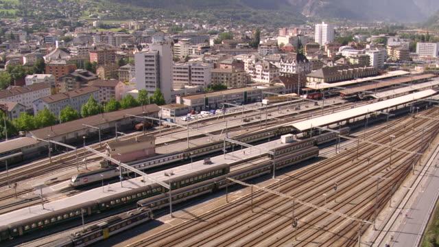 MS AERIAL Shot of rail station with Stockalper Castle / Brig, Valais, Switzerland