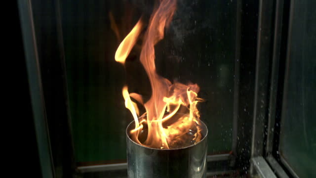 shot of rain extinguishing fire from tin bin - bin stock videos & royalty-free footage