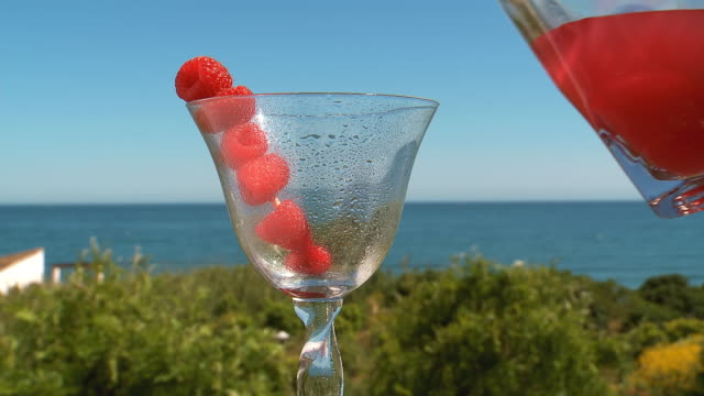 CU Shot of raspberry cocktail pouring in glass / Estepona, malaga, Spain