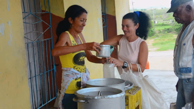 MS Shot of rations for food supplies with very little milk poured for people for one month welfare 14 / Trinidad, Cuba