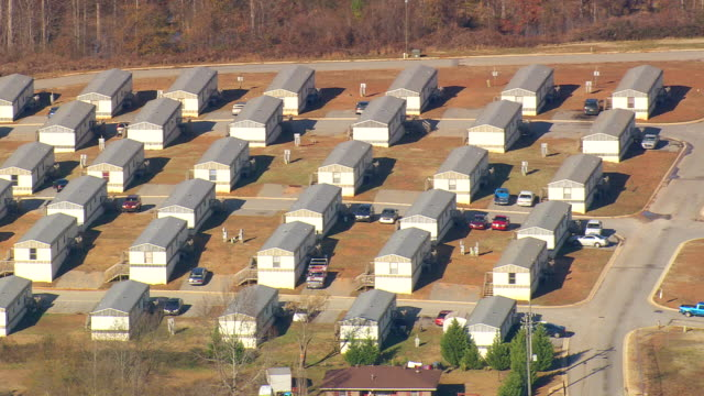 MS AERIAL Shot of raw houses with parking cars / Georgia, United States