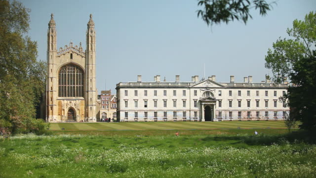 ws shot of rear of kings college with punters on river cam / cambridge, cambridgeshire, united kingdom - cambridge university stock videos and b-roll footage