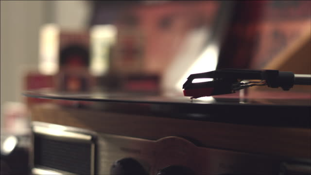 shot of record playing on turntable - deck stock videos & royalty-free footage